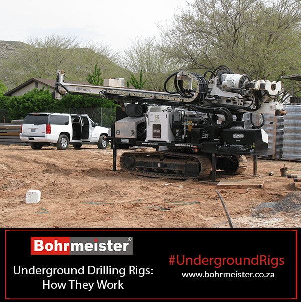 underground drilling rig outside with car in background